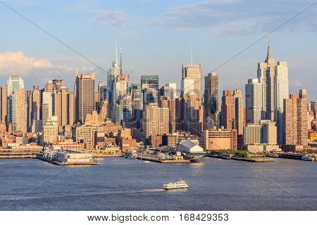 New York USA- May 20 2014. City view of New York City skyline midtown Manhattan in colorful sunset and clear blue sky.