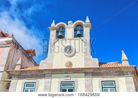 View of the bell tower in historical city center with Edificio do Relogio in Cascais Portugal