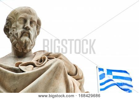 Statue of ancient Greek philosopher Plato and the greek flag in Athens.