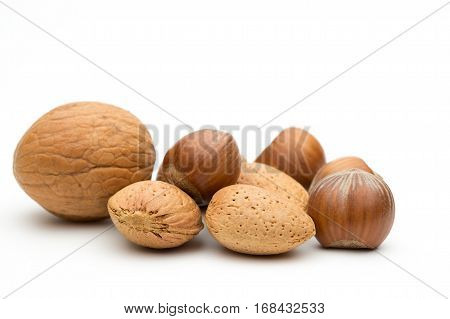 Small pile of assorted nuts, walnuts almonds and hazelnuts