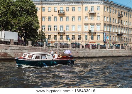 ST.PETERSBURG, RUSSIA - July 2, 2016: Tourists and travelers make the river walk along the rivers and canals of St. Petersburg, Russia