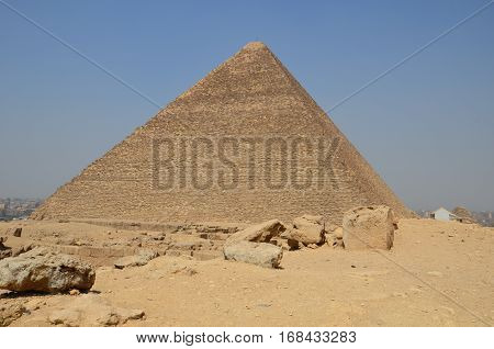 Pyramid In Sand Dust Under Gray Clouds
