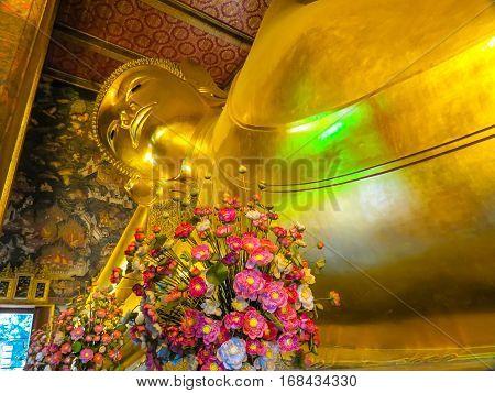 BANGKOK, THAILAND - JANUARY 16, 2014: Reclining Buddha's statue Wat Pho Temple or Temple of the Reclining Buddha. Bangkok, Thailand