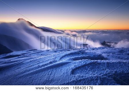 Amazing Foggy Sunset At Mountain Peak During Cold Winter Day In Mala Fatra, Slovakia