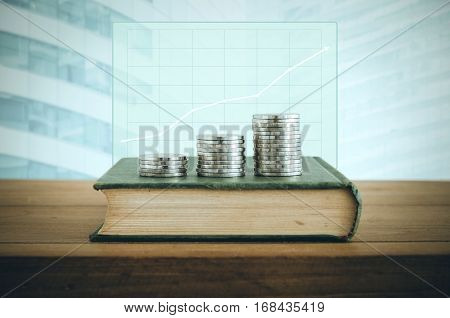 Money, Financial, Business Growth Concept, Coin Stacks On Old Book With Financial Graph.