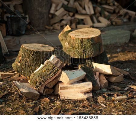 Background of dry chopped firewood logs in a pile.Pile of firewood.