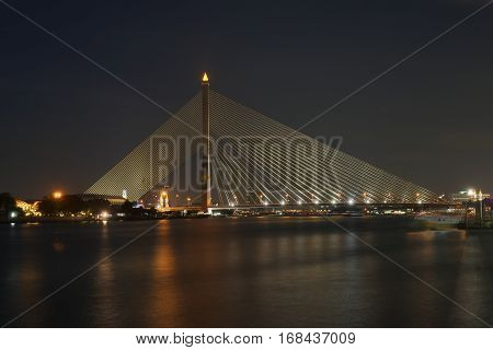Dominating the Chao Phraya River. The Rama VIII Bridge is a cable-stayed bridge crossing the Chao Phraya River in Bangkok, Thailand.