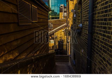 the narrow passage in the middle of the city, between buildings
