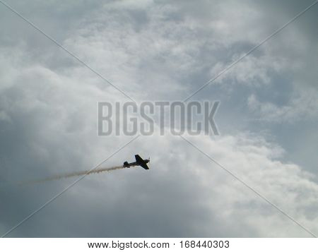 Photo of an aerobatic aircraft fyling in the sky