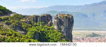 Aerial view of monastery at Meteora cliff in Greece and traditional greek Kalambaka town banner panorama