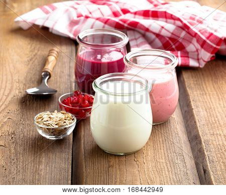 natural creamy yoghurt on a wooden background