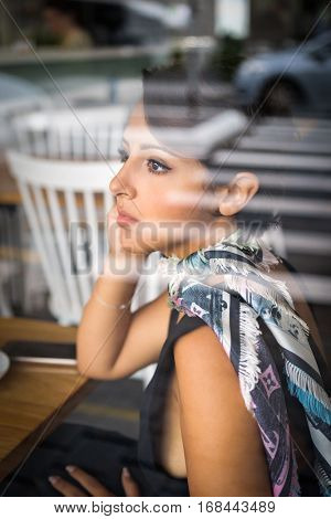 Beautiful woman sitting in cafe
