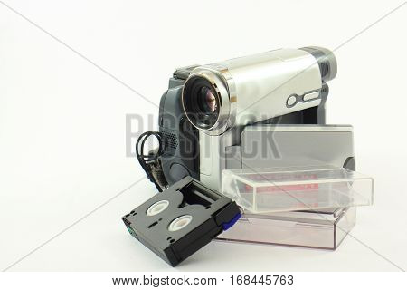 Digital video camera with tape on a white background