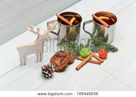 Chocolate Cookies And Mulled Wine With Cinnamon In Metallic Mug