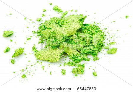 Crushed green eye shadow isolated on white background