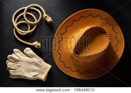 cowboy hat on black wooden background