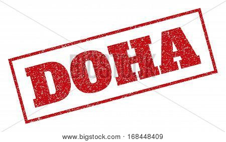 Red rubber seal stamp with Doha text. Vector tag inside rectangular frame. Grunge design and dust texture for watermark labels. Inclined sign.