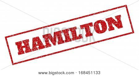 Red rubber seal stamp with Hamilton text. Vector message inside rectangular banner. Grunge design and dirty texture for watermark labels. Inclined sticker.