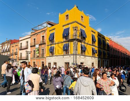 MEXICO CITY,MEXICO - DECEMBER 28,2016 : Huge crowd and colorful buildings at the historic center of Mexico City