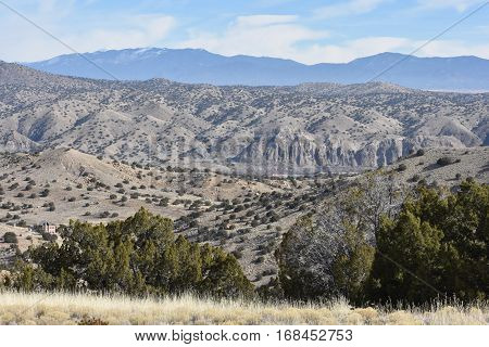 Landscape view of rural off grid cottage in high desert NM mountains