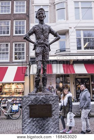 AmsterdamNetherlands-December 302016:Spui Square.Het Amsterdamse Lieverdje (the Little Amsterdam Darling).He's got a rascally glint in his eye and a mischievous impish grin