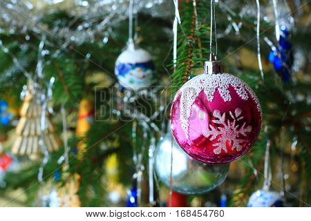 Christmas tree with red bulb with snowflakes
