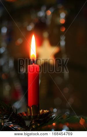 Christmas tree with red candle and star on background