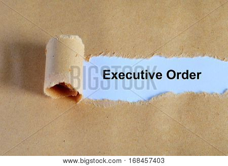 Executive Order Word Written Under Ripped And Torn Paper.