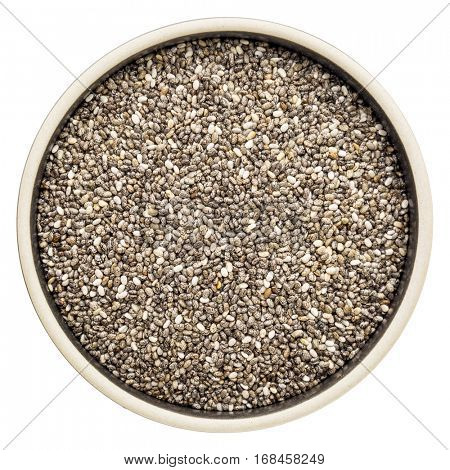 chia seeds (Salvia Hispanica) in a round ceramic bowl isolated on white