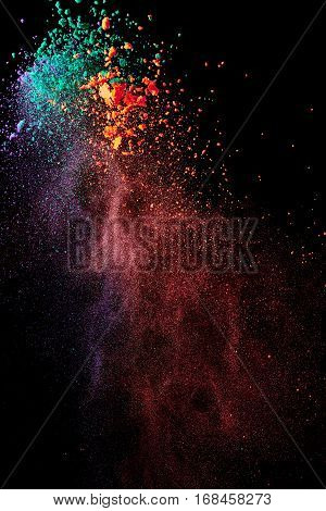 Splash of colorful powder on black background