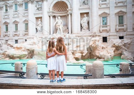 Little beautiful girls near fountain Fontana di Trevi