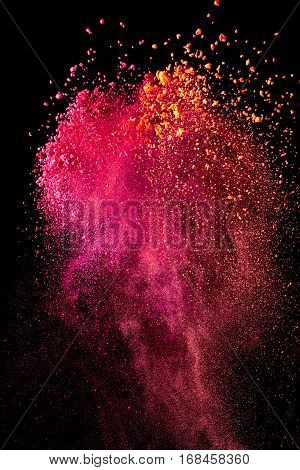Splash of bright powder on black background