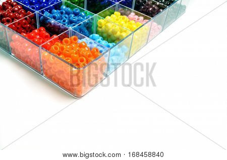 Colorful beads in bins for creating projects of art