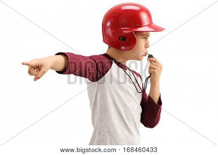 Boy in sportswear blowing a whistle and pointing with his hand isolated on white background
