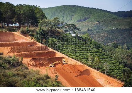 Diggers Excavate Terraces For Coffee Beans Plantations In Vietnam