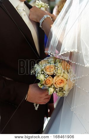Luxury Bride Putting On Boutonniere On Groom Suit At Wedding Ceremony.