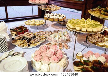 Delicious Decorated Candy Bar, Sweets On Tables For Wedding Reception, Catering In Restaurant