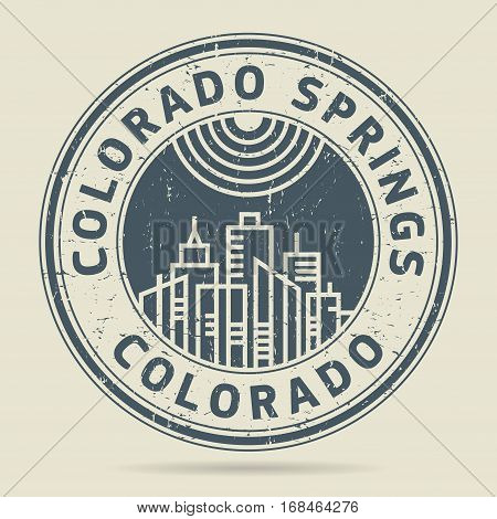 Grunge rubber stamp or label with text Colorado Springs Colorado written inside vector illustration