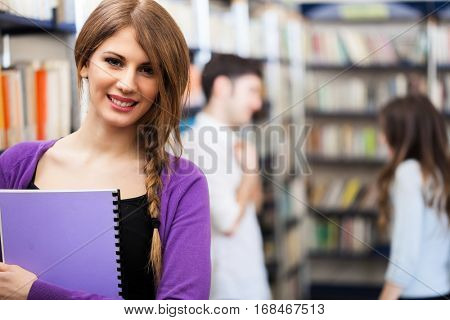 Smiling student in a library