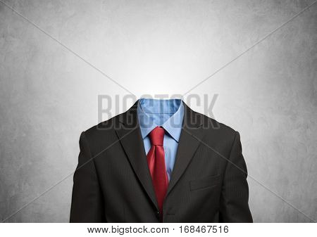 Headless businessman against a grey background