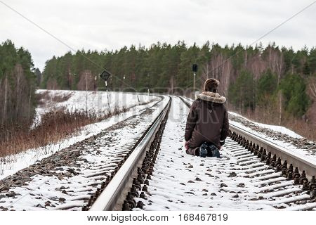 Depressed Young Boy On The Railway Tracks