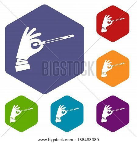 Magician hand with a magic wand icons set rhombus in different colors isolated on white background