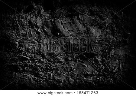 Grunge texture of the dark surface of the old dirty cement wall.