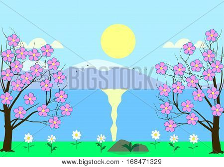 Flowering cherry on the river bank on a background of mountains, sun, blue sky