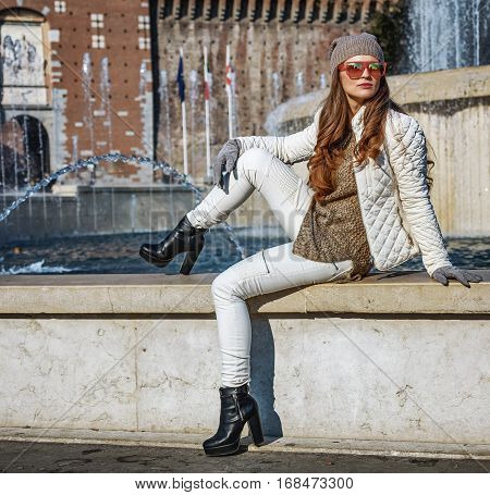 Modern Woman In Milan, Italy Sitting Near Fountain