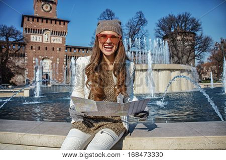 Rediscovering things everybody love in Milan. smiling modern tourist woman in Milan Italy with map