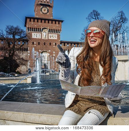 Traveller Woman Near Sforza Castle Holding Map And Pointing