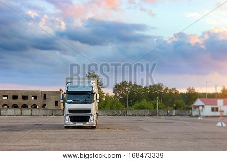 Narva, Estonia - August 20, 2016: Heavy truck loaded with goods trailer parked in waiting area on state border crossing. International hard transportation and logistics. Transport infrastructure