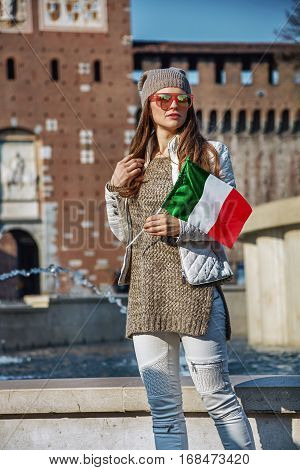 Tourist Woman In Milan With Italian Flag Looking Into Distance