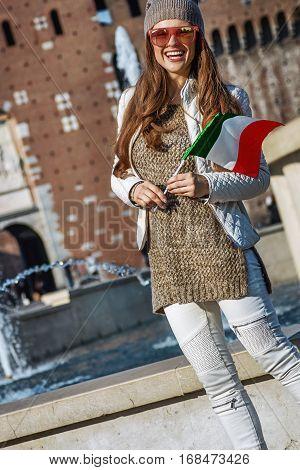 Traveller Woman Near Sforza Castle In Milan With Italian Flag